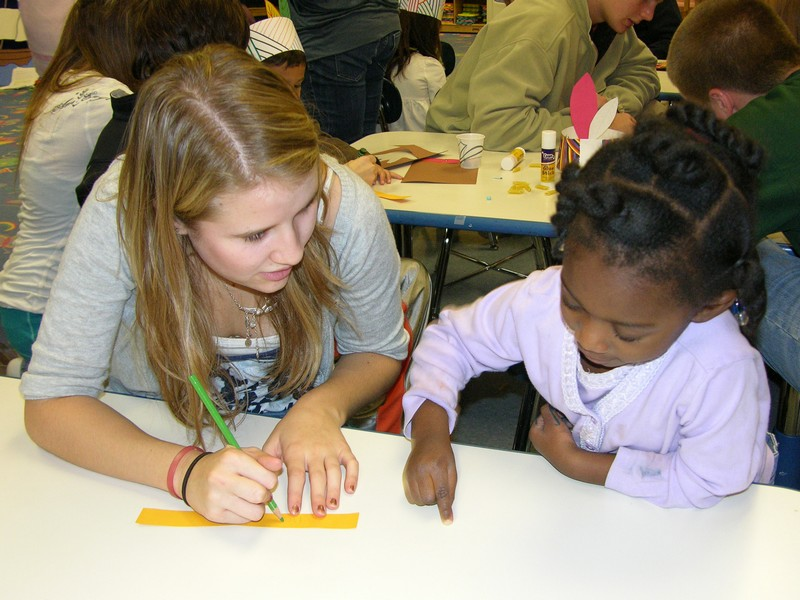 A CHS student works with a child