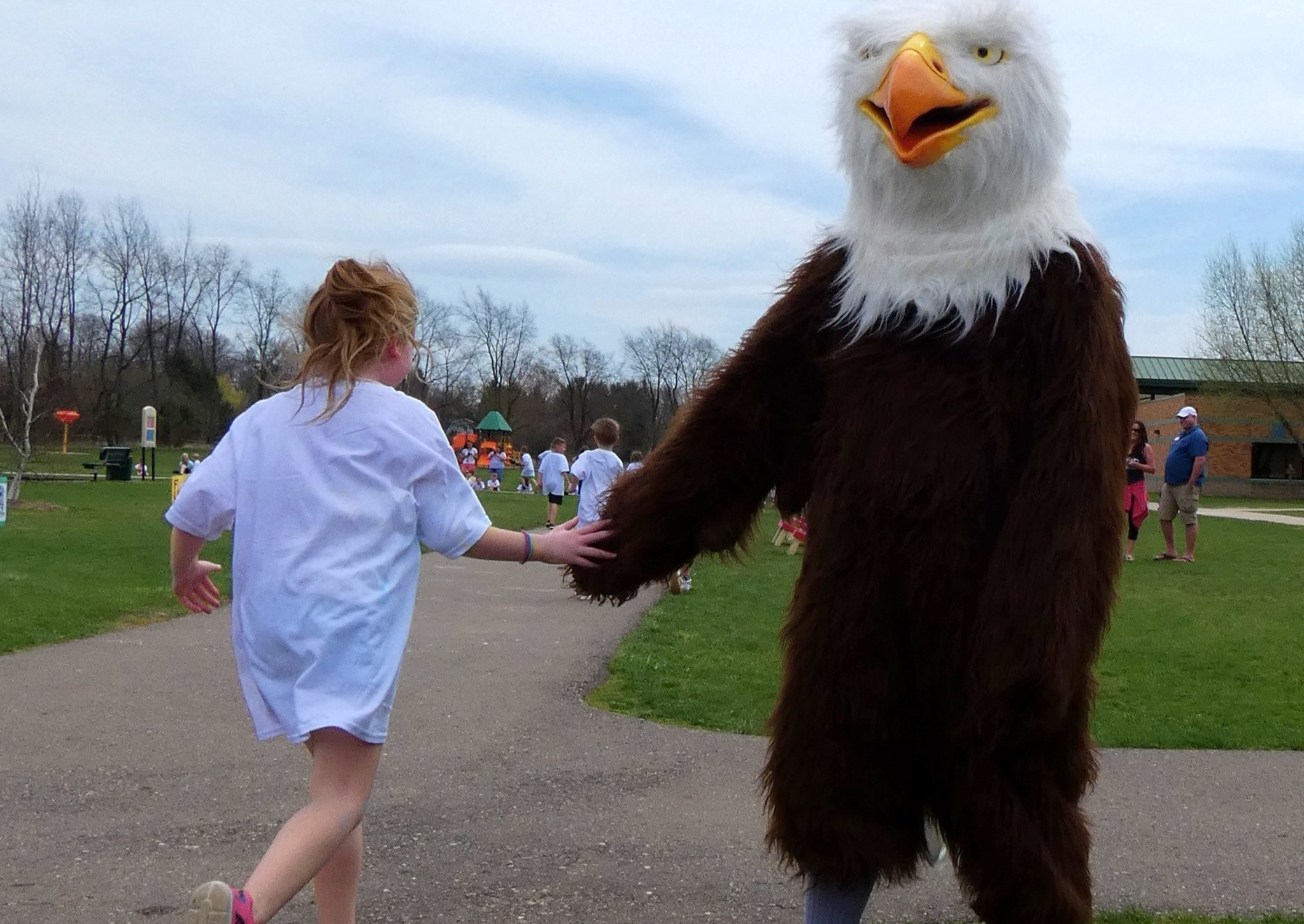 AE Eagle High Fives a student